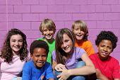 stock photo of happy kids  - happy diverse kids or chldren - JPG