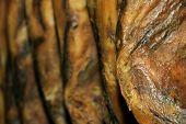 a closeup of a pile of serrano ham