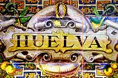 a Huelva sign writen in mosaic tiles