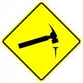 hammer and nail sign