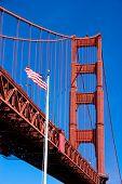 Golden Gate Bridge And American Flag