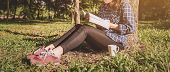 The Girl Sitting On A Green Grass With Cup Of Coffee And Reads The Book, Young Woman  With Coffee Si poster