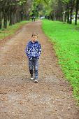 Im Looking Forward To The Future. Little Boy Enjoy A Brighter Future. Little Boy Walk Along Footpath poster