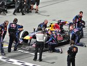 SEPANG, MALAYSIA - APRIL 4: Pit crews prepare Mark Webber's car of Red Bull Racing Team at Malaysian