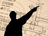 Contractor pointing a Blueprint Detail