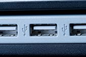 A side view of a laptop computer's USB ports