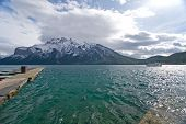 Beautiful Rocky Mountain lake in Alberta, Canada in autumn fall season and storm clouds