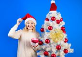 Christmas, Winter Holidays, Happiness, Celebration Concept. Charming Woman In Santa Hat Holds Gift I poster