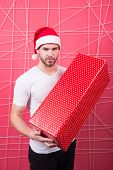 Christmas Holiday Celebration. Man Handsome Unshaven Santa Hat Hold Gift Box. Christmas Gift Concept poster