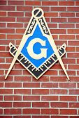 Freemason emblem on a a brick wall