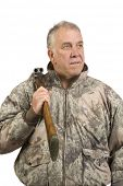 Man with a double barrelled side by side 20 gauge shotgun over shoulder - isolated