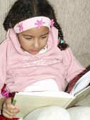 foto of storytime  - kid sitting in the sofa and reading a book - JPG