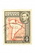 BRITISH GUIANA - CIRCA 1940 : A vintage postage stamp image of a map of South America showing British Guiana, and a face value of 4 cents, series circa 1940