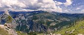 panorama of Yosemite National Park, with Half dome on the left, Nevada and Vernal Falls in the center