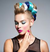 Beautiful woman with fashion hairstyle and pink nails.  Fashion portrait of young caucasian model wi poster