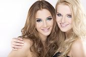image of blonde woman  - Two smiling attractive girl friends  - JPG