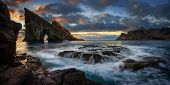 Panorama Of Drangarnir Rocky Arch On Vagar Island In Sunset, Faroe Islands poster