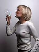 Young Woman Blowing Soap Bobbles, studio shot