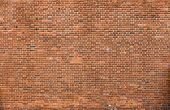 Close-up Of Natural Old Vintage Weathered Red Brown Not Plastered Solid Brick Wall. Abstract Copy Sp poster
