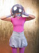 Disco Girls with Glitter Ball On Head In Night Club