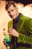 Handsome Glamorous Man In Green Jacket Holding Glass With Cocktail On Party With Smoke poster