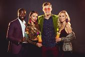 Smiling Glamorous Multiethnic Friends With Alcohol Cocktails On Party poster