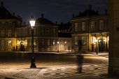 Amalienborg, The Palace And Residence In Copenhagen Of The Queen Of Denmark By Night With The Royal  poster