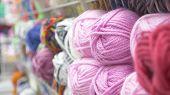 Colorful Threads. Knitting Pattern Of Colorful Yarn Wool On Shopfront. Knitting Background. Knitting poster