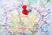 Map with the city of Baltimore, Maryland pinpointed with a red thumb tack
