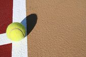 Tennis ball on the line with copy space