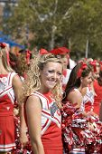 Ohio State Cheerleader smiling for the fans