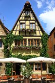 Quaint cafe in Rothenburg, Germany with flowering window boxes