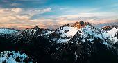 Sunset Illuminates A Beautiful Mountain Panorama. North Cascades National Park, Washington poster