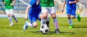 Running Soccer Football Players. Footballers Kicking Football Match Game. Young Soccer Players Runni poster