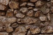 foto of fieldstone-wall  - stone wall more colorful randomize stones good texture - JPG
