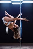 pic of pole dancer  - Young strong pole dance woman - JPG