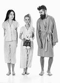 Man With Beard, Cute Blonde And Brunette Girls With Toy Bear Just Wake Up In Morning. Sleepy Morning poster