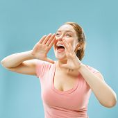 Do Not Miss. Young Casual Woman Shouting. Shout. Crying Emotional Woman Screaming On Blue Studio Bac poster