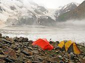 high mountain climbing base camp against Bezenghi Wall glacier in Caucasus mountains near Elbrus