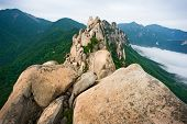 Famous Ulsanbawi Rock against the fog seorak mountains at the Seorak-san National Park, South korea