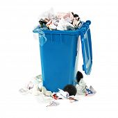 overflowing blue garbage bin on white background