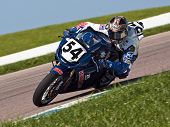 TOPEKA, KS - AUG 2:  AMA Superbike racer, Geoff May, travels through the turns at the Tornado Nation