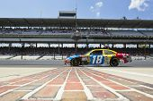 INDIANAPOLIS, IN - JULY 23:  Kyle Busch brings his M&M's Toyota across the bricks for the Brickyard