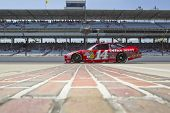 INDIANAPOLIS, IN - JULY 23:  Tony Stewart brings his Old Spice Chevrolet down pit road for the Brick
