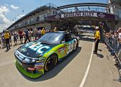 INDIANAPOLIS, IN - JULY 24:  Carl Edwards brings his Aflac Ford back into the garage area for the Br