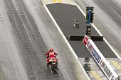 CONCORD, NC - MAR 28:  Ange Smith takes her pro stock motorcyle down the track at the zMax Dragway f