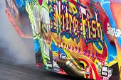 CONCORD, NC - MAR 27:  Tony Pedregon brings his Chevy Impala Funny Car down the track at the zMax Dr