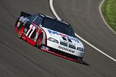 FONTANA, CA - OCT 08, 2010:  Sam Hornish, Jr. brings his Mobil 1 Dodge through the turns during a pr