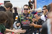 FONTANA, CA - MAR 27: Kyle Busch (18) walks through the line of fans before the start of the Auto Cl