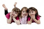 Three Adorable little girls isolated on white background